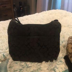 Coach shoulder bag blk has marks on zipper Medium